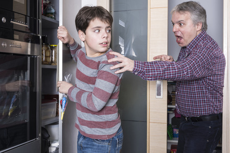 Father surprises his son taking candy photo
