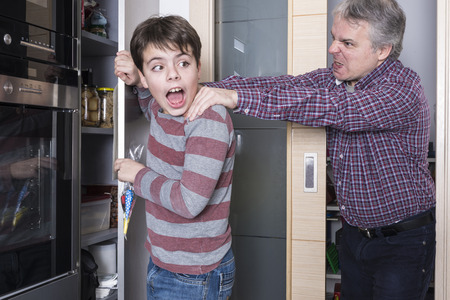red handed: Father surprises his son taking candy