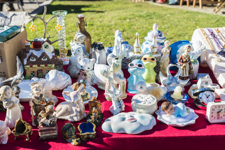 Girona, Spain - December 28, 2014: Objects used, furniture, artwork and ornaments on a market stall in the flea market in Girona, also known as Mercat de la Lleona