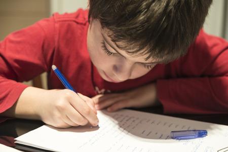 boy room: Child doing school homework at home Stock Photo