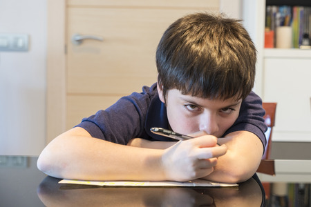 Child doing school homework at home Stock Photo