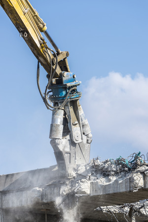 breaking down: A crane breaking down a building