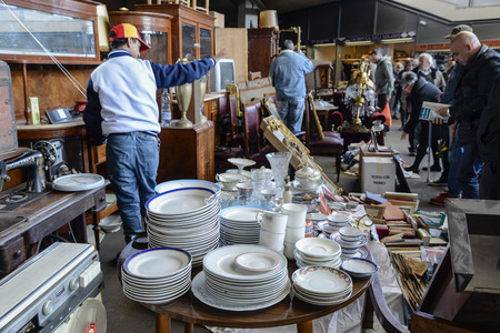 antiquities: Barcelona, Spain - March 12, 2014: The most famous flea market in Barcelona, also known as Els Encants or Els Encants Vells, located in Glories neighborhood. Customers choosing and looking for something interesting. The scene takes place in second hand an Editorial