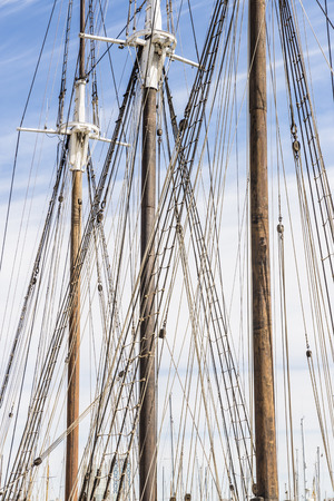 furled: masts and furled sails of an old sailing ship in the port of Barcelona