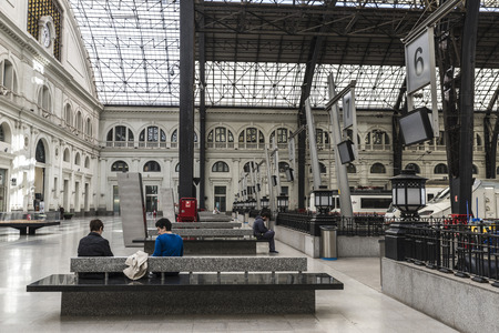 Barcelona, Spain  April 9, 2014: Panoramic of train waiting for departure in Estacio de Franca in Barcelona with people waiting. France Station is a historic railway station in the city of BarcelonaPanoramic of train waiting for departure in Estacio d Editöryel