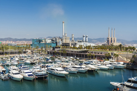 Port Forum, a sports harbor, with a waste incineration plant surrounded by a park and a thermal power plant closed in the background photo