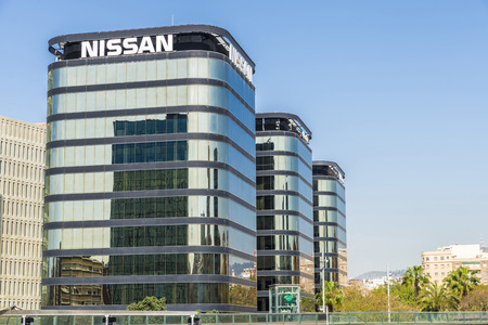 mirrored: Barcelona, Spain - April 11, 2014: Skyscrapers in the new district office in Barcelona. In the picture looks offices Nissan, Microbank and VidaCaixa. Behind the offices of the City of Justice.