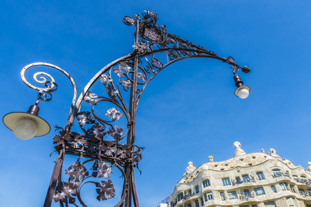 barcelona: View of Casa Mila, better known as La Pedrera, designed by Antoni Gaudi, and a modernist style streetlight on the Passeig de Gracia, Barcelona, Catalonia, Spain. It is the best exponent in modernist architecture.