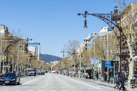 Barcelona, Spain - March 27, 2015: View of Passeig de Gracia after its recent reform, one of the most expensive streets in Europe