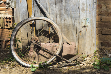 Old abandoned bicycle wheel in a cottage photo