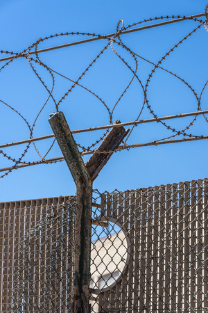 y shaped: Barbed wire against the sky Stock Photo