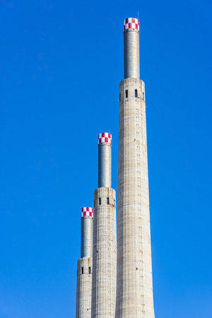 cement chimney: Three chimneys of a thermal power plant closed in Barcelona, Catalonia, Spain