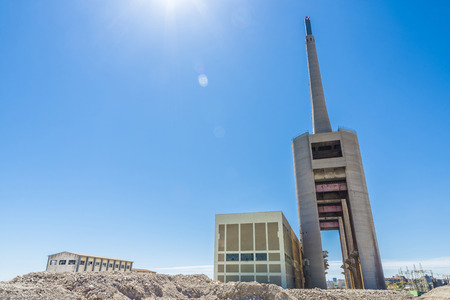 cement chimney: Thermal power plant closed with three chimneys in Barcelona, Catalonia, Spain Stock Photo