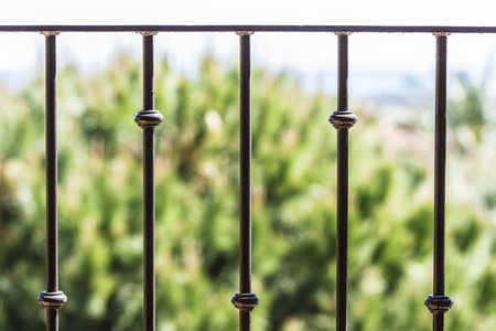 Closeup of black metal railing Foto de archivo