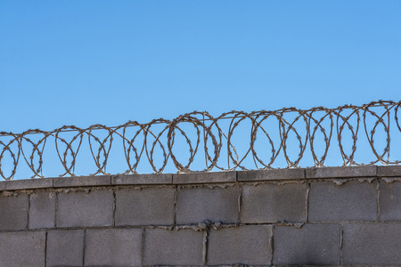 barbed wire frame: Barbed wire against the sky Stock Photo