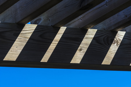 rafters: Wooden rafters against the sky in a play of light and shadow
