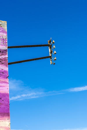 electricity pole: Electricity pole attached to a purple wall