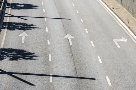 dashed: Arrow signs and dashed lines on asphalt