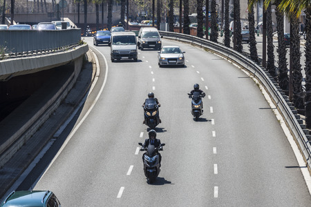 express lane: Crossing rapid urban roads in Barcelona, Catalonia, Spain Stock Photo