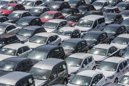 shipped: New cars parked in a row in the port of Barcelona, Catalonia, Spain. They are waiting to be shipped.