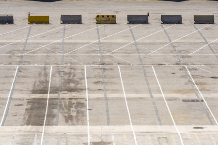 dividing lines: Empty parking at the loading dock of the port of Barcelona, Catalonia, Spain