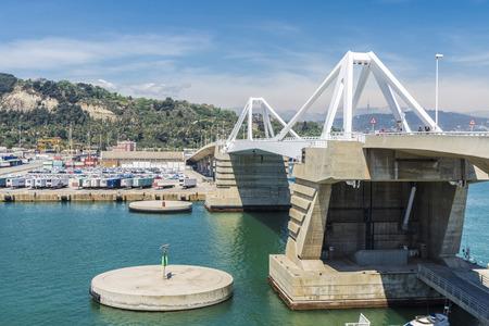 loading dock: Barcelona, Spain - May 2, 2015: Drawbridge over the port and loading dock in Barcelona Catalonia, Spain