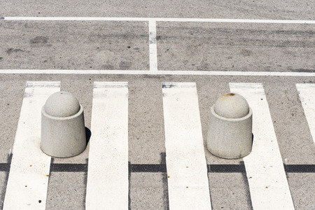 pedestrian crossing: High view of a pedestrian crossing with two bollards Stock Photo