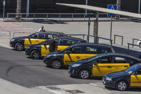 Barcelona, Spain - May 23, 2014: Taxi stand with their drivers waiting at the cruise terminal in the port of Barcelona