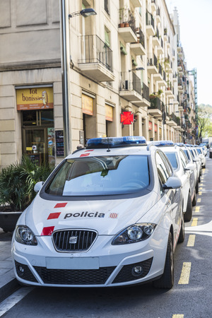 Barcelona, Spain - May 8, 2015: Row of police cars in the old town of Barcelona. The Mossos Esquadra is a police force that operates only in Catalonia