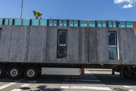 Truck carrying a module prefabricated concrete housing in Barcelona, Catalonia, Spain photo