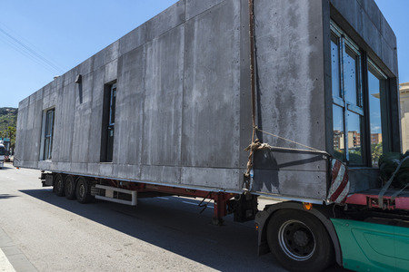 oversize load: Truck carrying a module prefabricated concrete housing in Barcelona, Catalonia, Spain