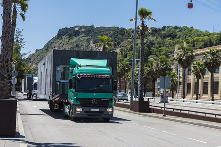 oversize load: Barcelona, Spain - May 21, 2015: Truck carrying a module prefabricated concrete housing