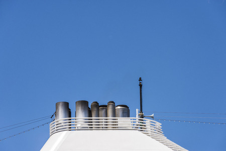 Chimneys of a modern and luxurious cruise against clean sky