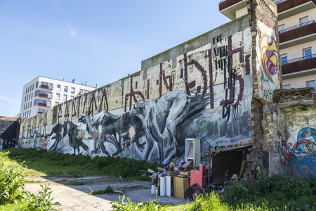 barrack: Barcelona, Spain - April 9, 2015: Wall covered with graffiti of dogs running beside a barrack