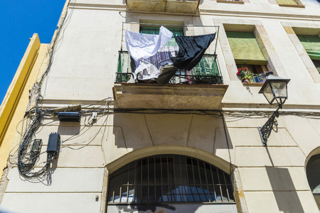 botch: Hanging clothes outside a small balcony of old building in the old town of Barcelona, Catalonia, Spain Stock Photo