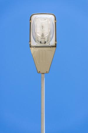 Closeup of street light against the blue sky photo