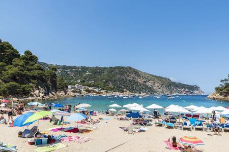 bathers: Girona, Spain - June 30, 2015: Aiguablava beach with sunbathers of all ages in Costa Brava, Catalonia, Spain