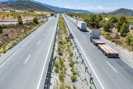 express lane: Highway through Andalusia between olive groves in Spain