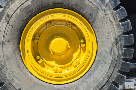Yellow wheel of a big truck load