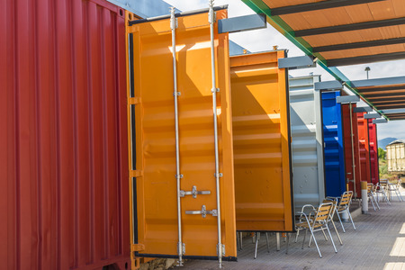 Bar made containers lined up and painted colors in Spain