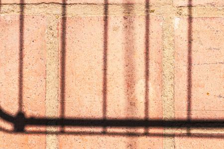 Rectilinear shadows on a clay tile an outdoor terrace