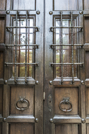 iron barred: Old barred door in Pals, Girona, Catalonia, Spain