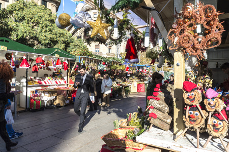 Barcelona, Spain - December 19, 2014: Santa Llucia Fair is a Christmas market. The most important figure is the birth of baby Jesus, caganer and caga tio