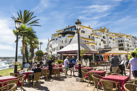 spain: Puerto Banus, Spain - August 15, 2015: Bar with customers where you can drink watching the sea  in Puerto Banus, Marbella. Editorial