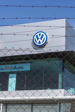 automaker: Barcelona, Spain - October 10, 2015: Volkswagen headquarters in Barcelona, next to the SEAT factory, protected by a security fence, located in the Zona Franca. Volkswagen is the largest German automaker