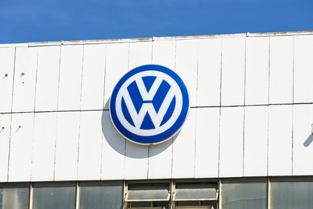 automaker: Barcelona, Spain - October 10, 2015: Volkswagen sign on a wall of the factory in Barcelona located in the FTZ. This company is the largest German automaker Editorial