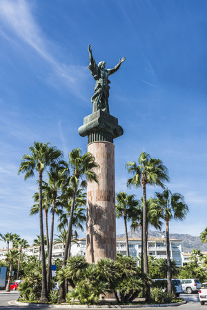 outstretched arms: Victory statue, also known as the Russian statue, in Puerto Banus, a marina near Marbella in Costa del Sol, Spain. It created by sculptor Zurab Tsereteli, is a column of 30 meters crowned by a figure with outstretched arms.