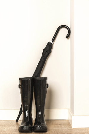 wellies: Black wellies and umbrella ready for use in a rainy day