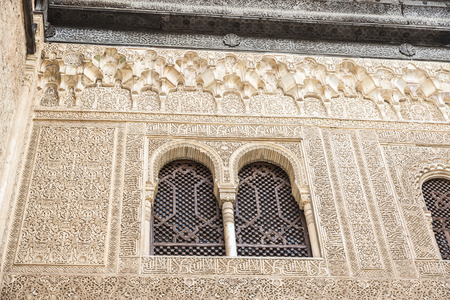 poems: Granada, Spain - August 11, 2015: Walls decorated with geometric shapes and epigraphic poems in the Alhambra, Andalusia, Spain
