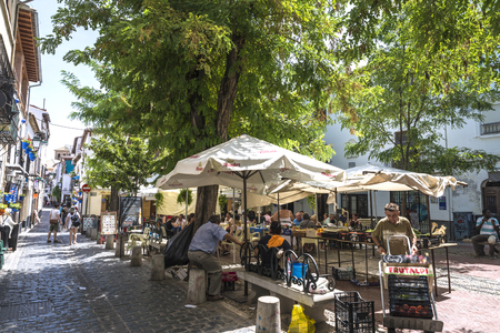 Granada, Spain - August 12, 2015: Flea market in the historic district of Albaicin, opposite the hill of the Alhambra in Granada